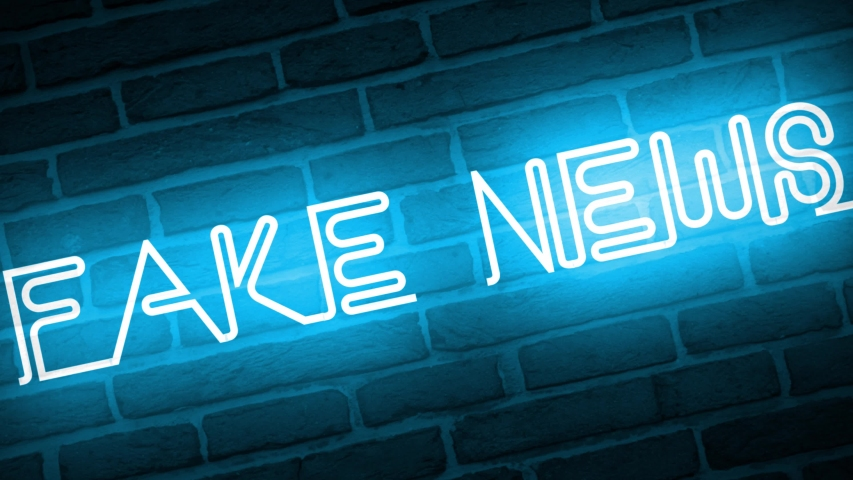 A video of a neon sign against a brick wall that reads: Fake News | Shutterstock HD Video #1042745134