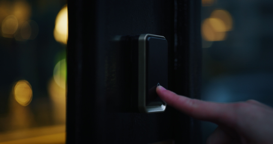 Close up of a male finger is pressing a ring bell in the evening. | Shutterstock HD Video #1042776910