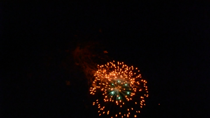 Colorful fireworks that explode and fill the darkness of the night sky with colored light.  | Shutterstock HD Video #1042779295