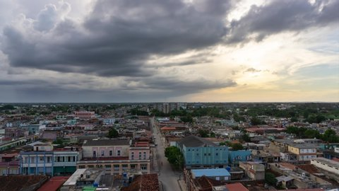 Time Lapse of an Aerial Panoramic view of a small Cuban Town, Ciego de Avila, during a cloudy and colorful sunset. Located in Central Cuba.