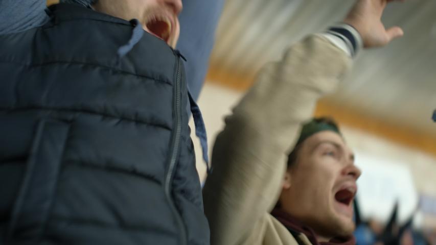 Scream guy sport hockey watch goal win close up happy fan expressive shouting background crowd 4K. People with friend hockey match cheering win game. Fan man screaming happy goal sport team. | Shutterstock HD Video #1042784686