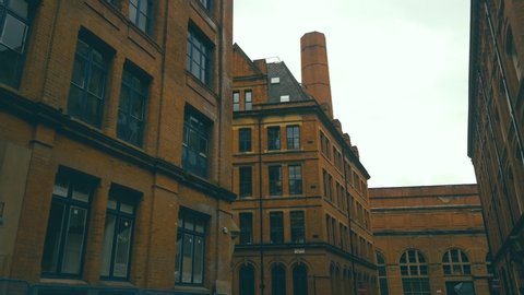 Red brick buildings. Historic Streets and Buildings in the Center of Manchester, England.