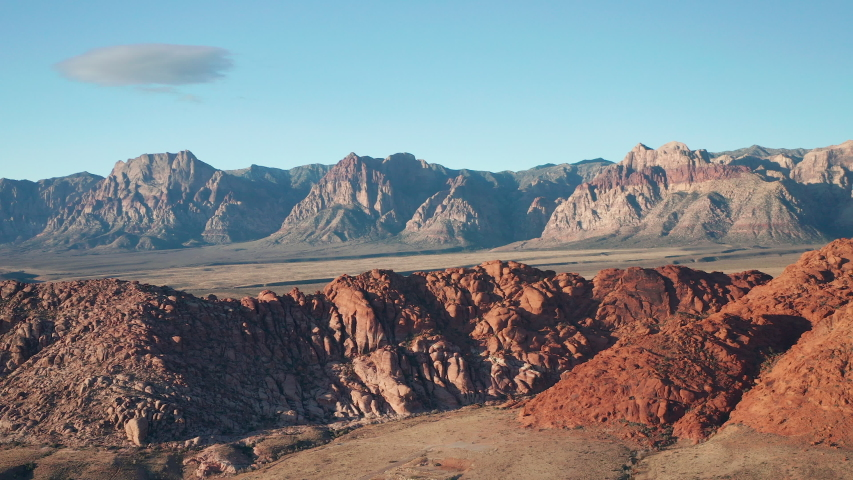 Aerial wide sideways dolly shot of Red Rock Canyon mountains and Calico Basin | Shutterstock HD Video #1042808140