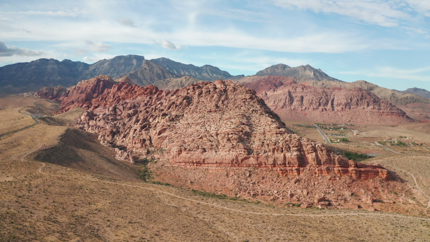 Aerial pullback shot of colorful sandstone cliffs, mountains in Red Rock Canyon | Shutterstock HD Video #1042808146
