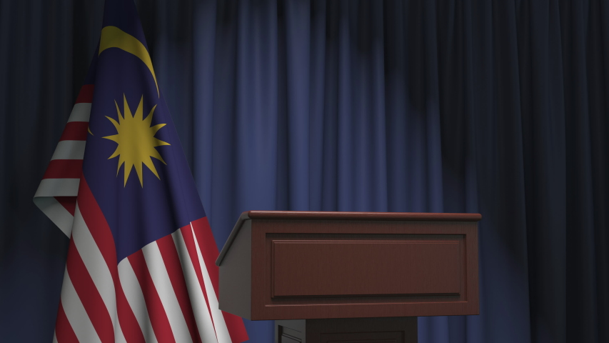 National flag of Malaysia and speaker podium tribune. Political event or statement related conceptual 3D animation | Shutterstock HD Video #1042820539