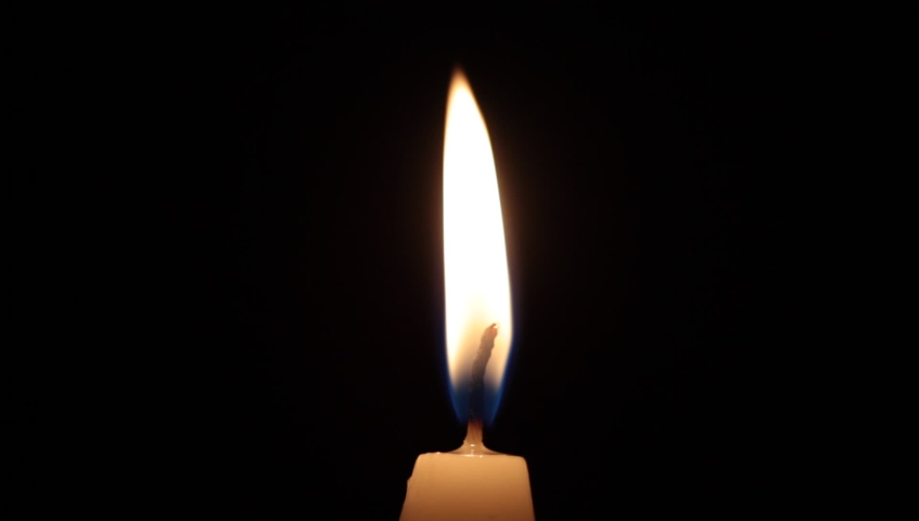 Close-up Single Candle Flame Isolated on Black Background Royalty-Free Stock Footage #1042860127