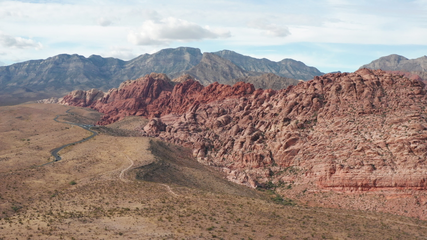 Aerial pullback view of colorful Calico sandstone cliffs in Red Rock Canyon | Shutterstock HD Video #1042860412