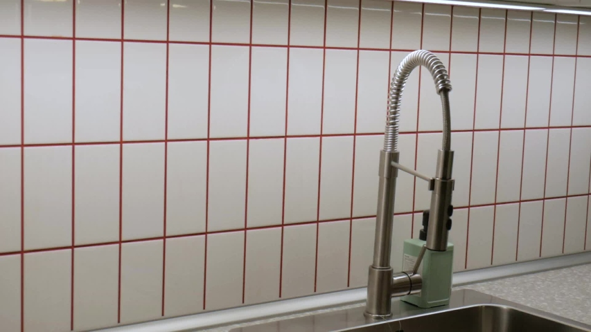 Kitchen made of fine tiles with red lines.  | Shutterstock HD Video #1042879906
