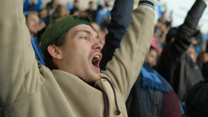 Male spectator sport hockey match joy goal win closeup happy fan expressive scream background crowd 4K. People with friend hockey game cheering winning team. Fan man scream happy goal favorite team. | Shutterstock HD Video #1042881832