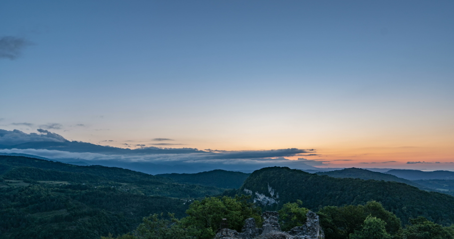 Time lapse of clouds and sunrise in the mountains, Formation of cumulus clouds, beautiful summer landscape