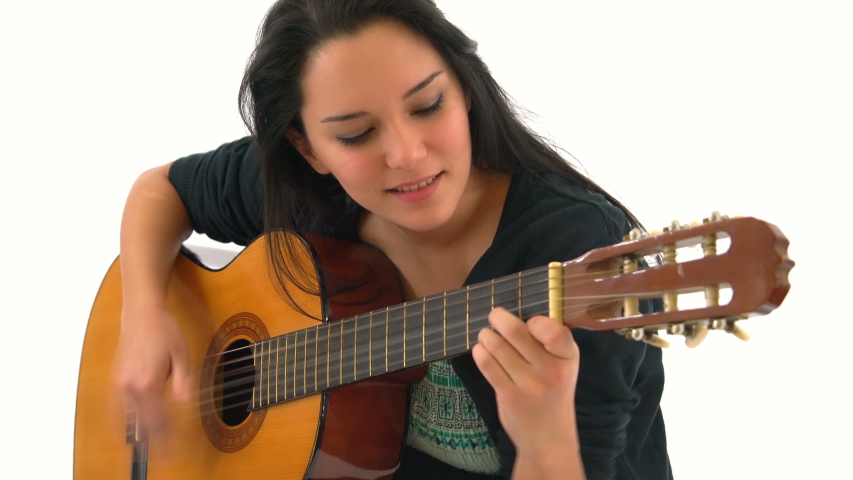 Happy Young Woman Playing Classical Guitar Isolated on White Background