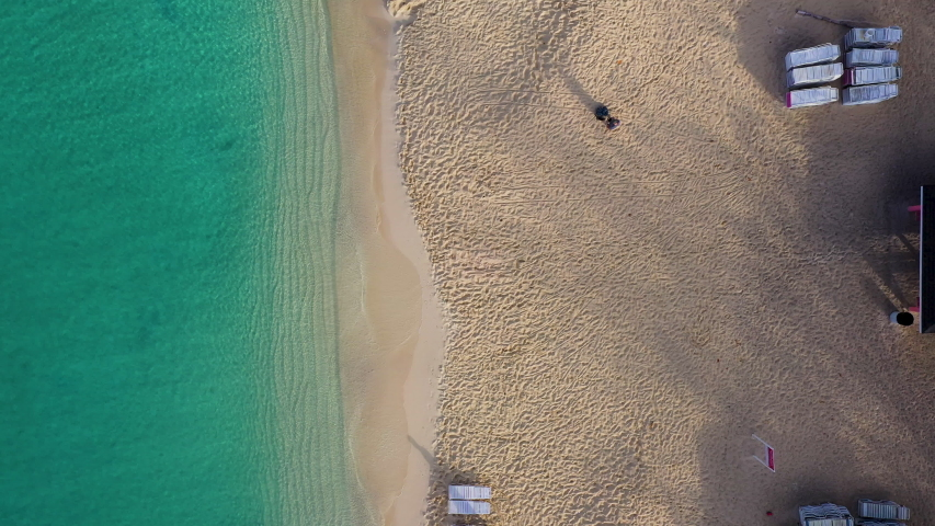 Aerial footage of seven mile beach and the north sound on the island of grand cayman in the cayman islands in the tropical waters of the caribbean sea