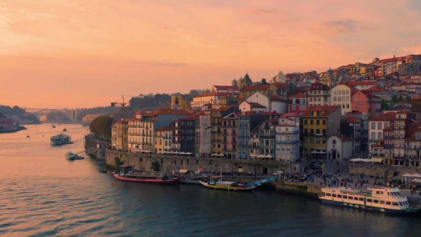 Porto, Portugal. Aerial view of the old city with promenade of the Douro river at sunset