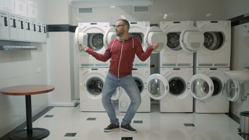 Man Dancing Swing And Have Fun In the Laundry  Room. Happy Man Enjoying Dance, Having Fun Together, Party. Floss Dance Viral, Flossing, swing. Royalty-Free Stock Footage #1042908808