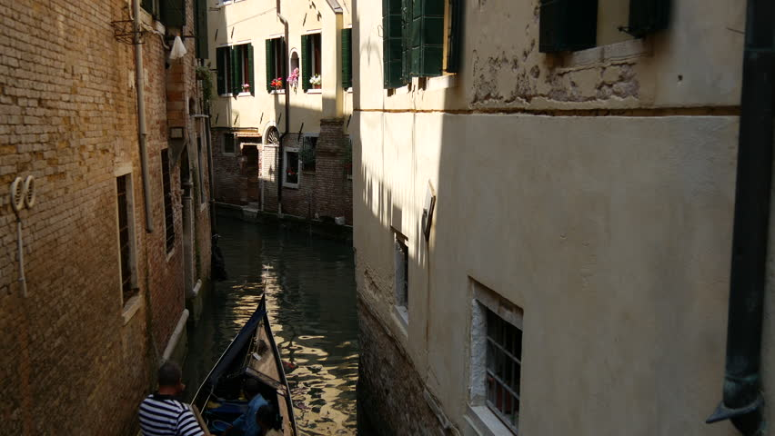 Gondola in a narrow canal in Venice Italy #10429202