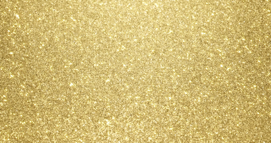 Gold glitter background with sparkling texture. Golden shimmering light, stars sequins sparks and glittering glow foil background | Shutterstock HD Video #1042924897