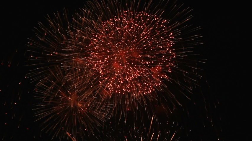 Shining fireworks with bokeh lights in the night sky, glowing fireworks show. New year's eve fireworks celebration. Multicolored fireworks in the black sky. | Shutterstock HD Video #1042940617