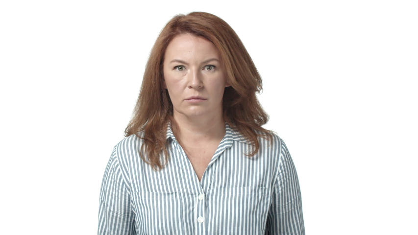 Woman trying act everything okay but feeling contempt, scorn. Redhead mature mother meet sons girlfriend stare angry and pissed, flick lip from disdain, start acting normal, fix hair and fake smile | Shutterstock HD Video #1042946002