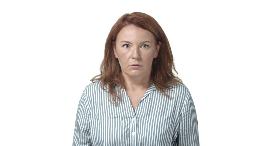 Startled and shocked, speechless adult redhead woman got in embarrassing nervous situation, look around with popped eyes full of fright and panic, stare alarmed, gulp from anxiety and worry | Shutterstock HD Video #1042946020