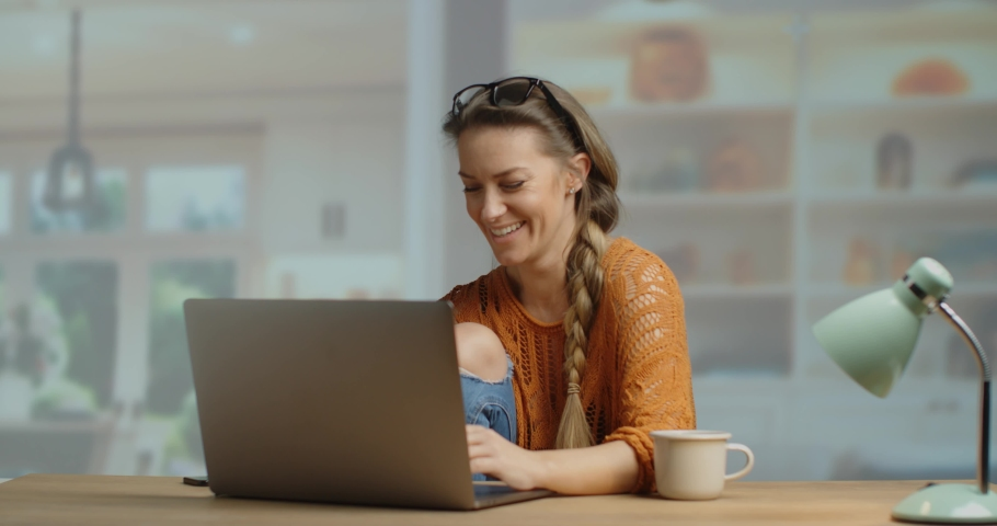 Super happy young woman holding a plasic bank card and buying online. happy shopper. Slow motion 4k | Shutterstock HD Video #1042953106