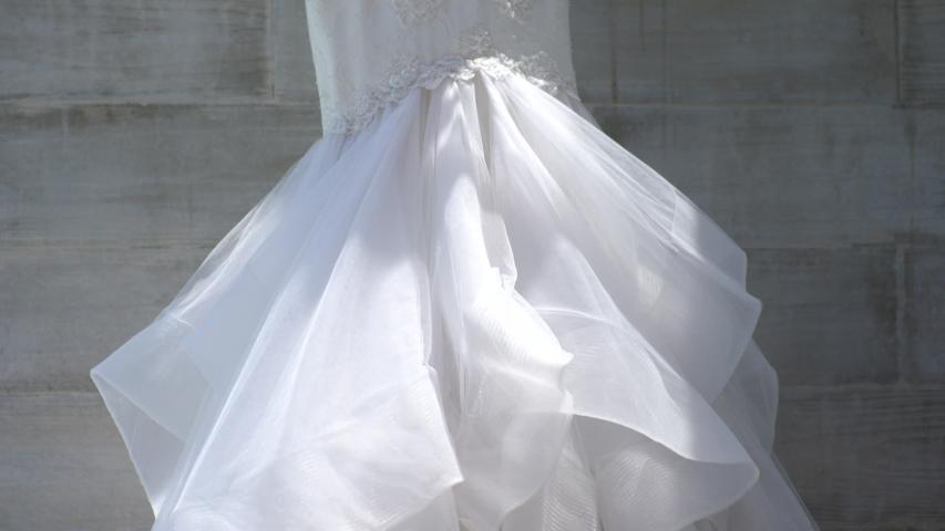 Wedding Dress at a Destination Wedding Resort Hanging in the Sun | Shutterstock HD Video #1042957999