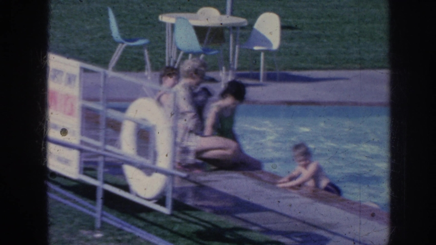 MEMPHIS TENNESSEE USA-1963: Old Video, Family Vacation, Video Of Family At Hotel Pool Swimming, Person Walking To Hotel Room
