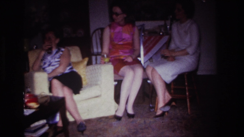 ROCKAWAY BEACH NEW YORK USA-1967: Three Women In Skirts And A Man At A Small Party | Shutterstock HD Video #1042964392