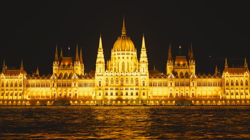 Night view of the river danube and the hungarian parliament in budapest, hungary | Shutterstock HD Video #1042971706