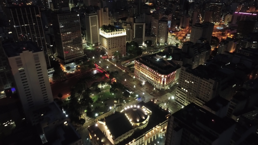 Aerial view of Chá's Viaduct, Municipal Theatre and Light's Shopping at night. Famous places of São Paulo's downtown, Brazil. Great landscape | Shutterstock HD Video #1042973560