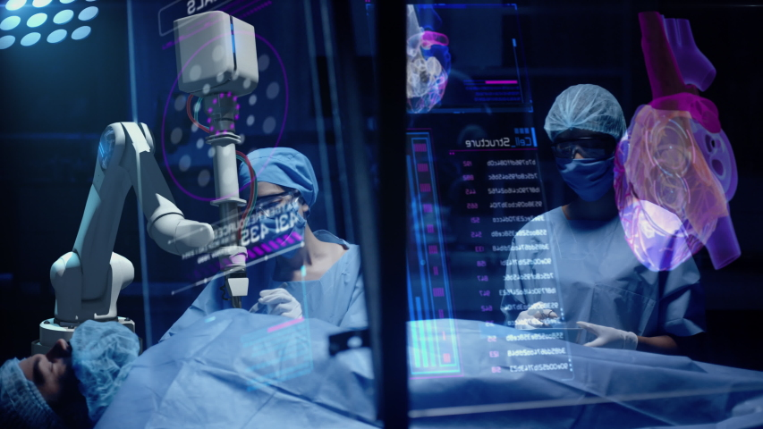 Team of Professional Surgeons perform a Delicate Operation using Medical Surgical Robot while observing Data on Transparent Screens. Modern medical equipment. Robotic arm for minimal invasive surgery. Royalty-Free Stock Footage #1042976131