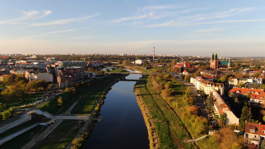 Aerial drone shot flying above Warta River and city Poznan Poland and in sunny day. | Shutterstock HD Video #1042992094