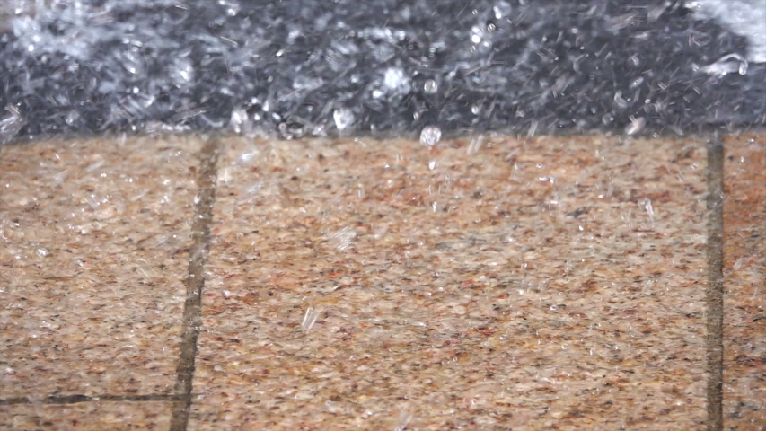 Close up of very heavy rainfall on a pavement, shot in 250 fps slow motion. | Shutterstock HD Video #1043005849