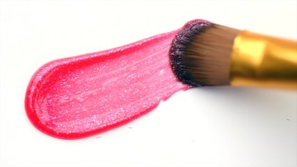 Lipgloss make-up smudge, smear. Cosmetic liquid lip gloss, lipstick pink color smudge, smear, stroke. Lip gloss Make up smears isolated on a white background. Brush. Smooth Texture. 4K UHD video