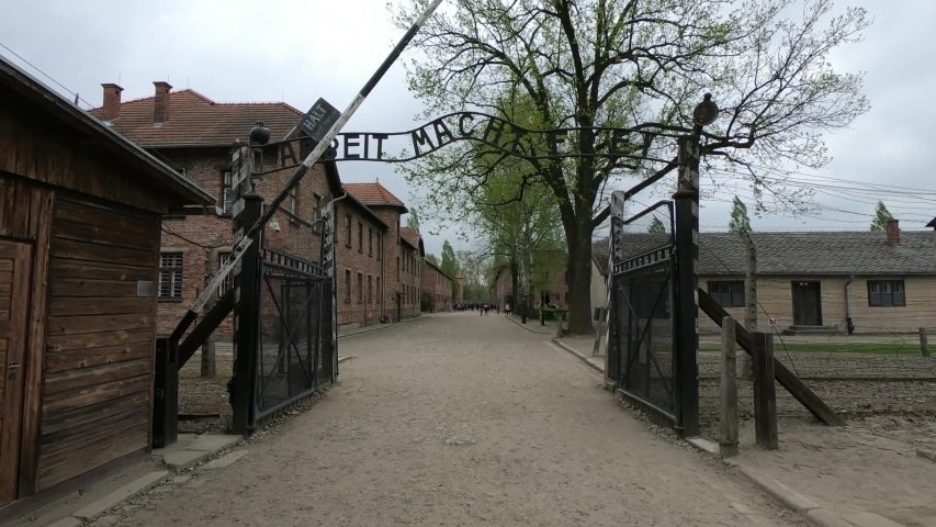 Oświęcim / Poland - April 27, 2019 - SLOW MOTION SHOT - Holocaust Memorial Museum. The Auschwitz I concentration camp was established in June 1940. The Arbeit Macht Frei Gate (work will set you free).