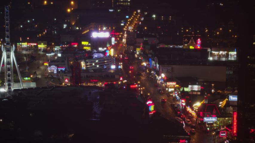 Niagara Falls Ontario Aerial v17 Reverse panning nighttime view of Niagara Falls, Ontario skyline cityscape - October 2017