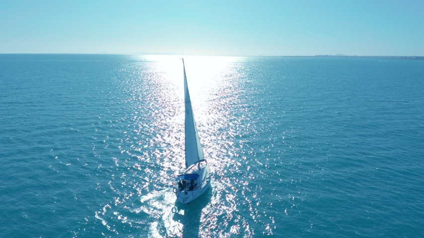 Aerial view. Traditional yacht sailing across sea. | Shutterstock HD Video #1043044453