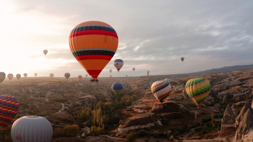 A balloon flies over Cappadocia, shooting from a drone in 4K