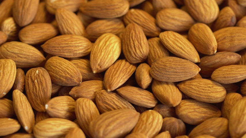 Nut almond close up. product rich in minerals and vitamins. Almond turns in a shot. Almond kernels rotating. walnut close up lies under beams of the sun. Macro | Shutterstock HD Video #1043053684