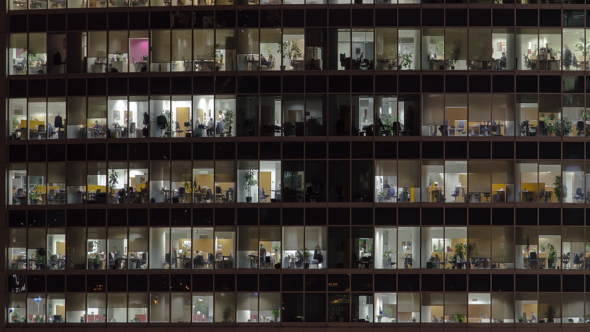 Close view to office windows in Skyscrapers International Business Center City at night timelapse from top, Moscow, Russia. Pan left and right, tilt up | Shutterstock HD Video #1043063479