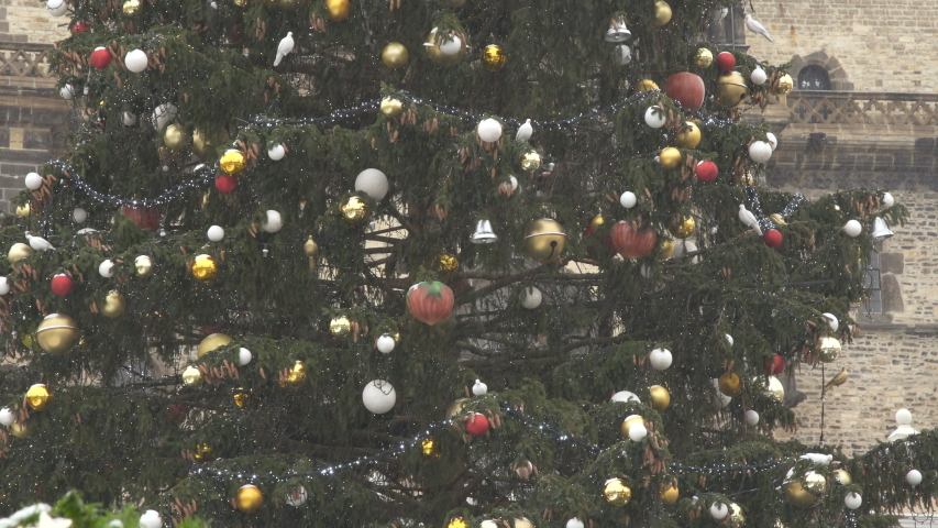 Christmas tree with balls garland in Old town Square in Prague. Snow fall | Shutterstock HD Video #1043091199