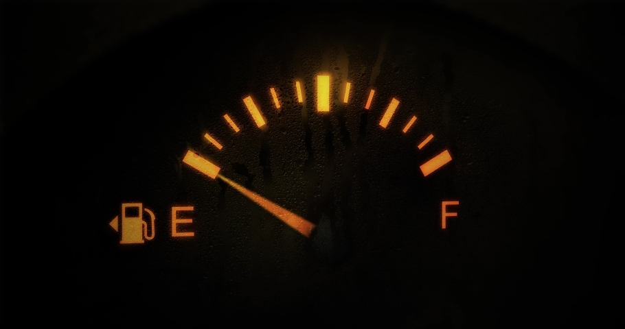 Fuel Gauge Car Dashboard Fills up. Orange Light Turn Off when Tank is Full or Vehicle Activated. Close Up petrol meter on black background, Horizontal video clip in 4K. Gasoline Prices and Tax concept | Shutterstock HD Video #1043098492