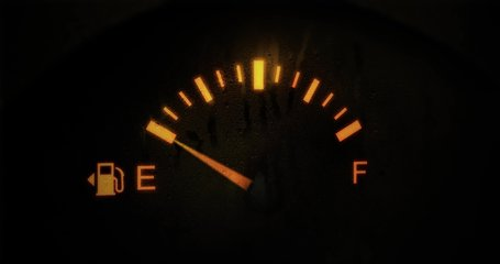 Fuel Gauge Car Dashboard Fills up. Orange Light Turn Off when Tank is Full or Vehicle Activated. Close Up petrol meter on black background, Horizontal video clip in 4K. Gasoline Prices and Tax concept