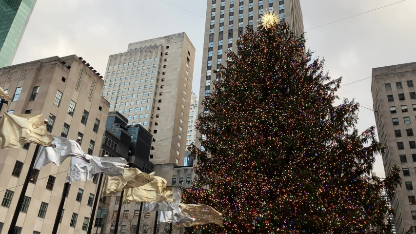 New York, NY / USA - Dec. 16, 2019: A view of the Rockefeller Center Christmas tree, a major tourist attraction in the city.