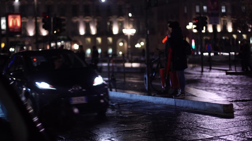 Night City Traffic, Cars Driving Along Night Street. 4k Video. TURIN, ITALY 12-17-2019