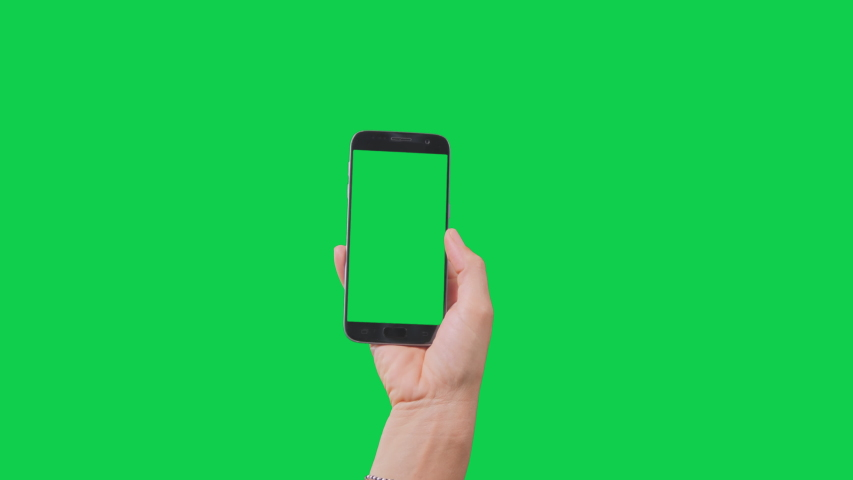 Green screen phone woman using smartphone browsing and tapping