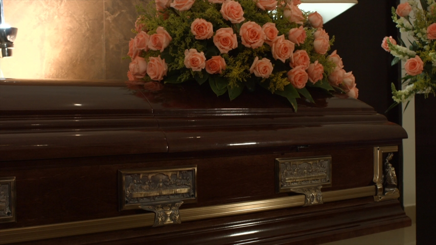 Coffin in the funeral chapel only in the coldness of death. The desolation that causes death. | Shutterstock HD Video #1043118262