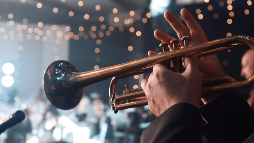 Trumpet player. Trumpeter hands playing brass music instrument close up. Detail of the player's fingers on trumpet. Close up of trumpet players fingers working the vavles | Shutterstock HD Video #1043162296