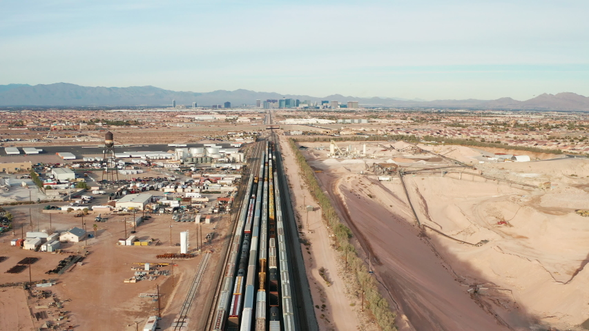 Aerial tilt shot of freight, cargo containers on railroad tracks in Las Vegas | Shutterstock HD Video #1043218567