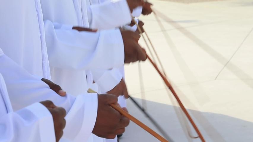 Traditional Emirati Yawalah male dance, UAE heritage, hands in frame Royalty-Free Stock Footage #1043273419
