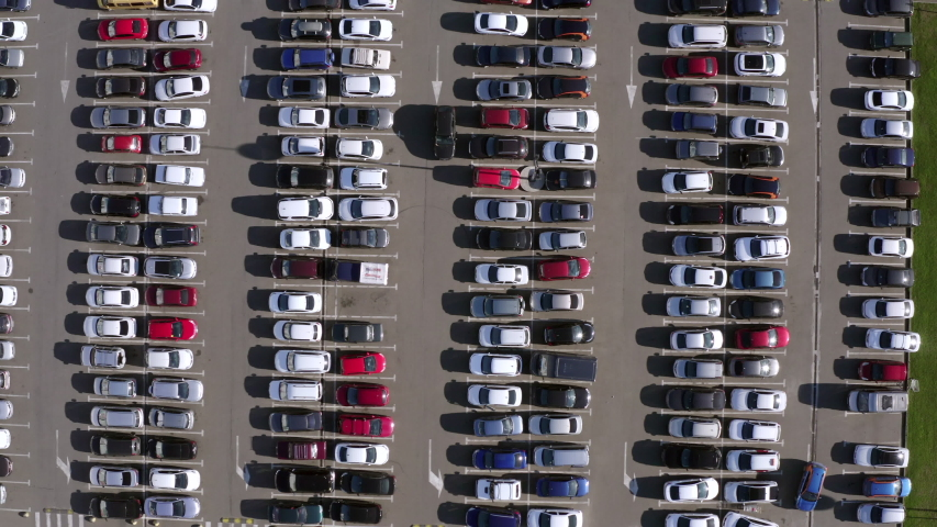 Top view black car driving and parked free parking space. Aerial view from above flying drone cars moving and standing on parking lot in modern city. Car traffic and parking concept Royalty-Free Stock Footage #1043308585